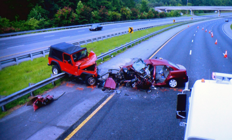 Jury sees unreleased photos from triple-fatal I-85 crash