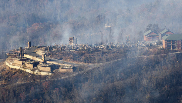 Burned structures are seen from aboard a National Guard helicopter near Gatlinburg, Tenn., Tuesday, Nov. 29, 2016. Thousands of people raced th_300280
