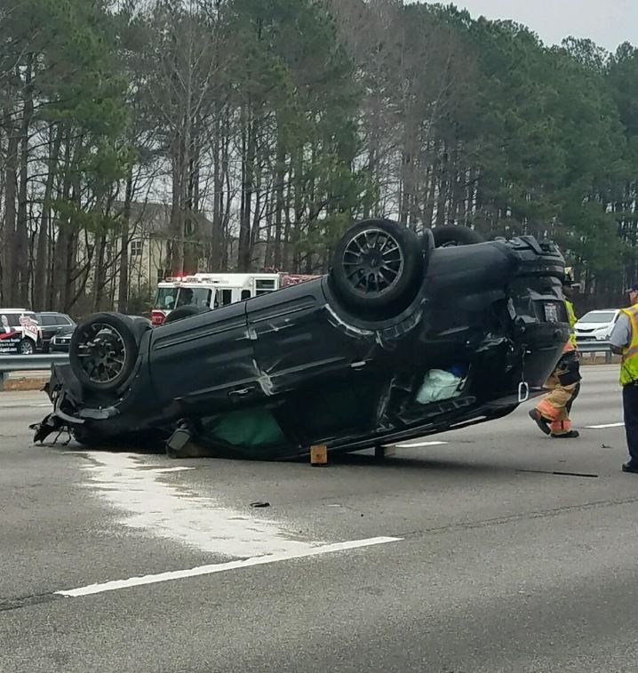 Man held at gunpoint following crash on I-40 in Raleigh now