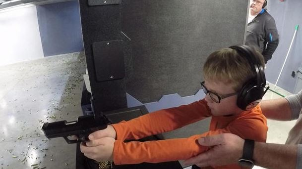 kid shooting gun_1521549941152.JPG.jpg