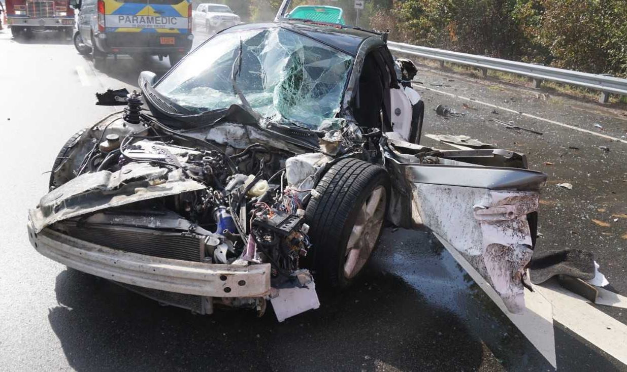 Car driver taken to hospital after collision with log truck