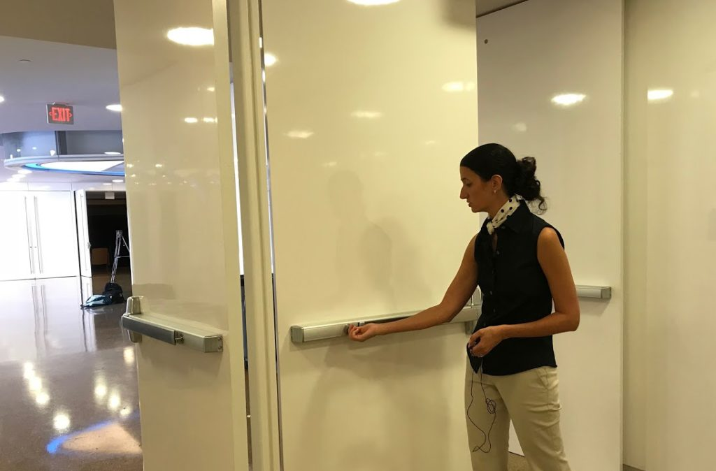 Kelly Hogan locks the doors of her classroom in Genome Sciences building. New locks have been installed in more than 200 classrooms. (Yakin Ouederni)