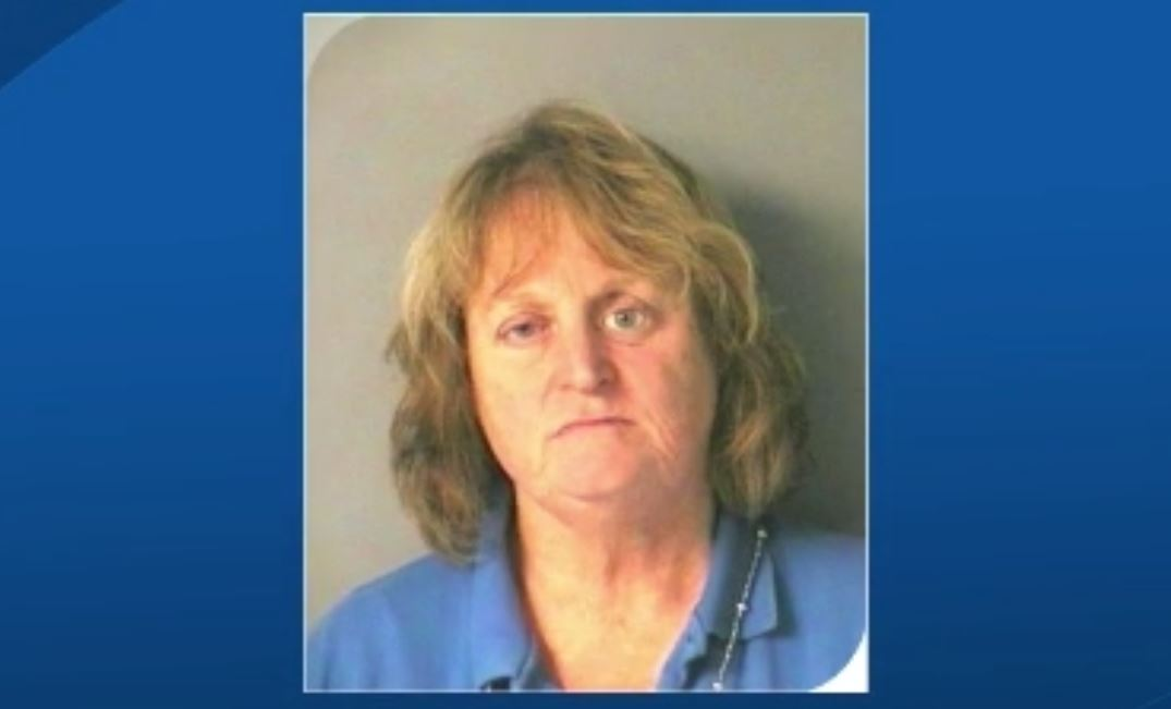 Woman accused of pushing elderly golden retriever into lake