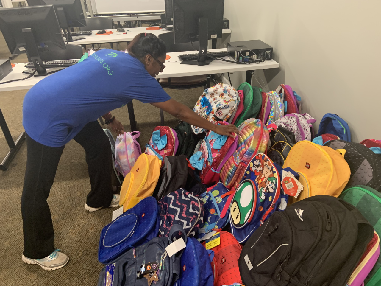 Durham Rescue Mission gives away backpacks, groceries