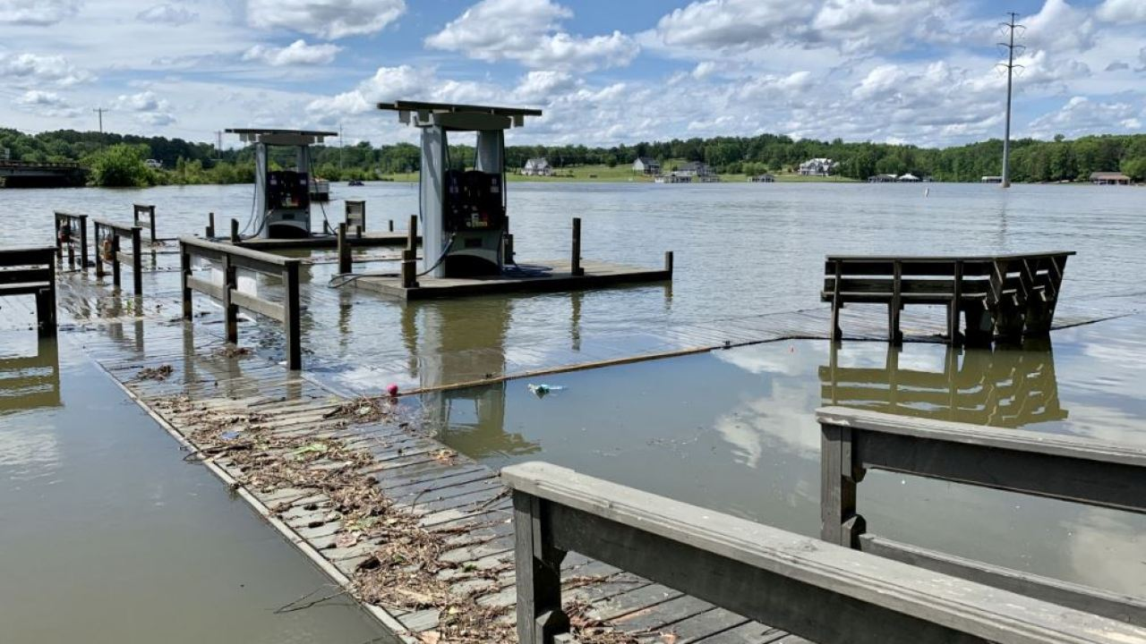Debris seen in NC lake after high water damages piers, floods areas
