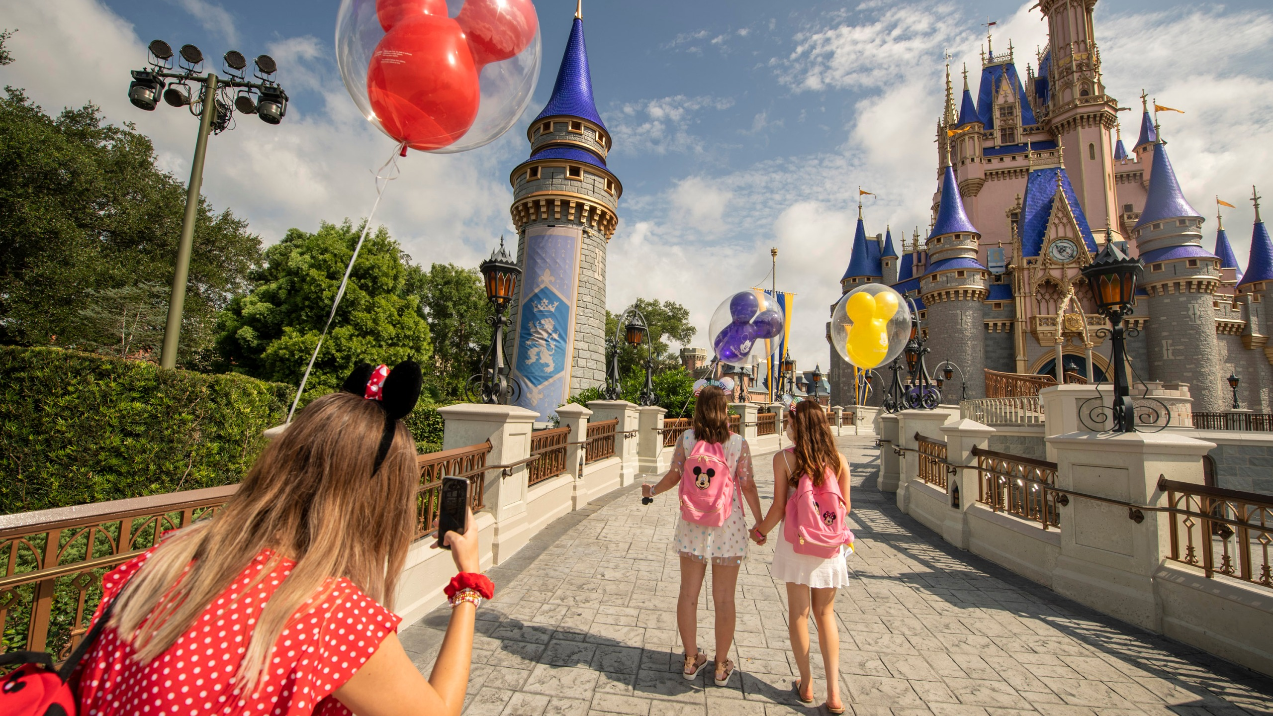 Masks And Mouse Ears: Walt Disney World Reopens Even As Coronavirus Cases Climb In Florida