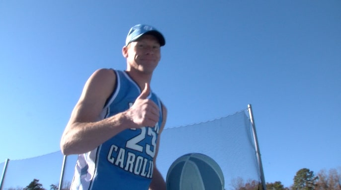 UNC track & field coach breaks world record for fastest mile while dribbling a basketball