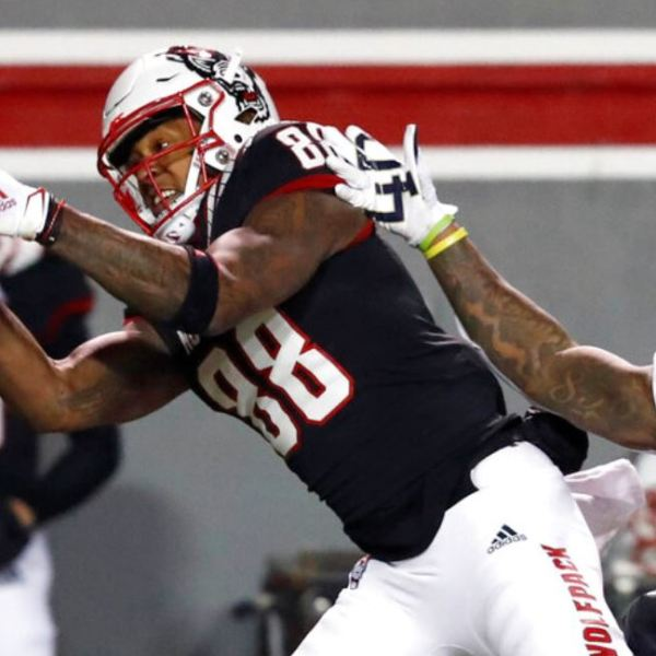 North Carolina State wide receiver Devin Carter (88) makes a reception as Georgia Tech defensive back Juanyeh Thomas (1) defends during the first half of an NCAA college football game in Raleigh, N.C., Saturday, Dec. 5, 2020. (Ethan Hyman/The News & Observer via AP, Pool)