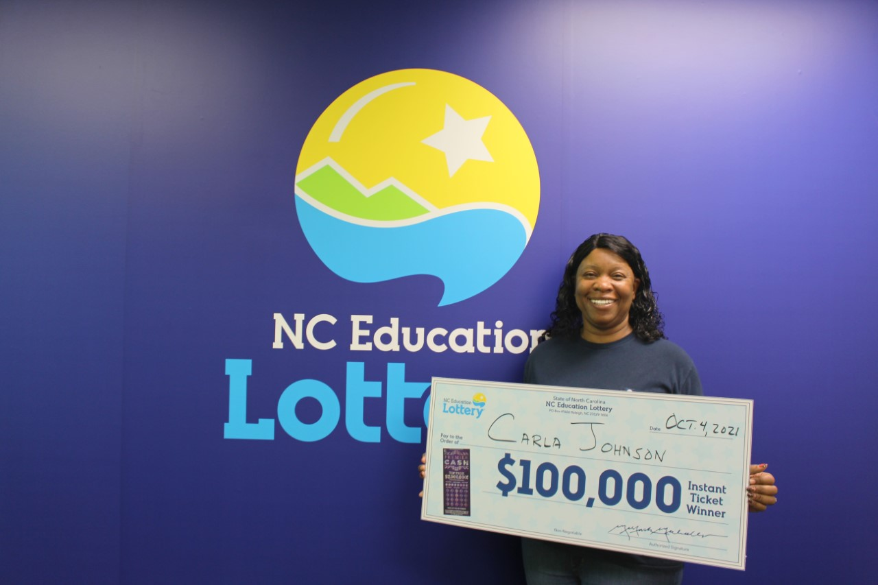Retired Army Sgt. Carla Johnson poses with her scratch-off winnings.
